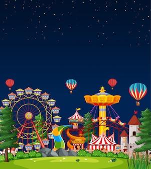 Scène de parc d'attractions la nuit avec un ciel bleu foncé vierge
