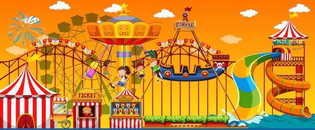 Scène de parc d'attractions pendant la journée avec un ciel jaune