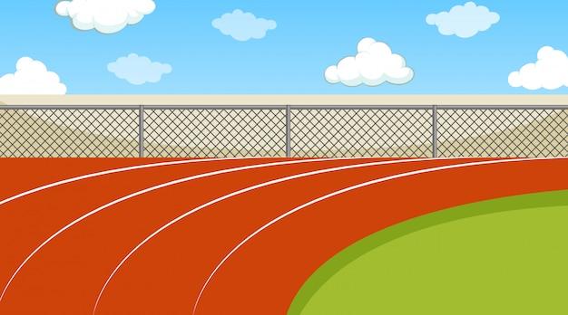 Scène avec piste de course et champ vert
