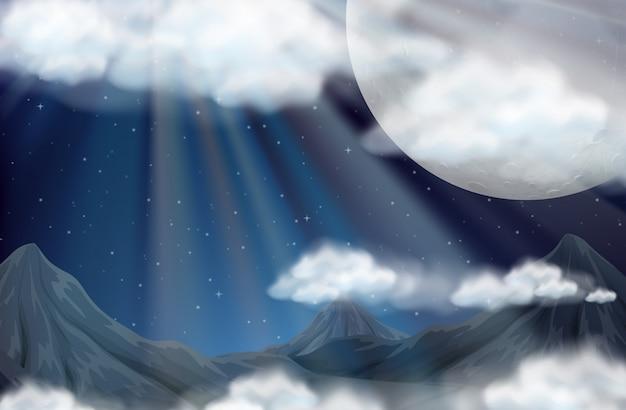 Scène avec la pleine lune et les montagnes