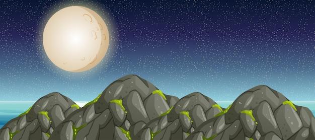 Scène avec pleine lune et montagnes