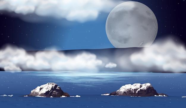 Scène avec la pleine lune sur l'océan