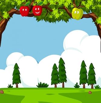 Scène avec des pommiers et champ vert