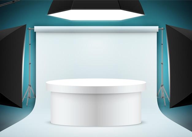 Scène de prise de vue de produits professionnels avec papier de fond de table ovale blanc et lumières de studio