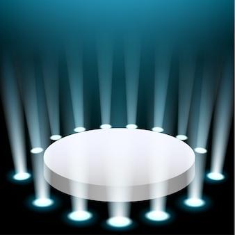 Scène avec des projecteurs bleus qui brillent vers le haut