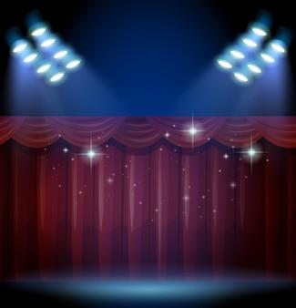 Scène avec rideau rouge et de nombreuses lumières
