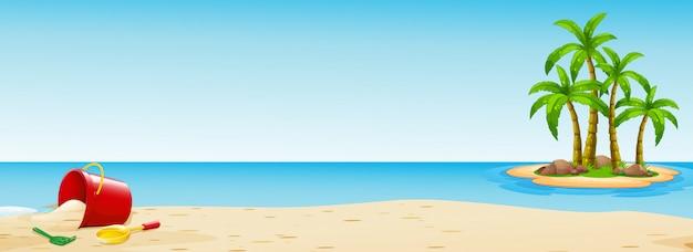 Scène avec seau sur la plage