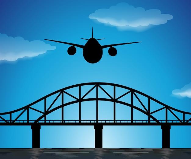 Scène de silhouette avec avion volant dans le ciel bleu