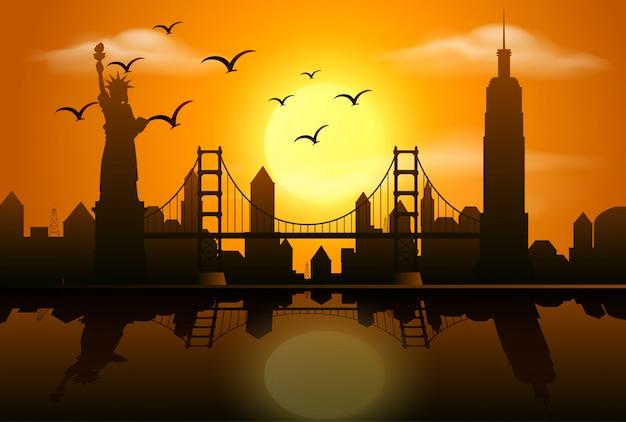 Scène de silhouette avec des bâtiments dans la ville au coucher du soleil
