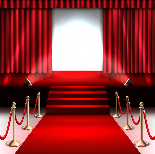 Scène avec tapis rouge et projecteur et barrière dorée.