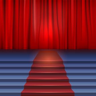 Scène de théâtre avec rideau rouge et tapis.