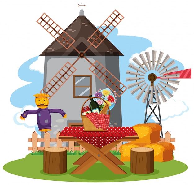 Scène avec tour de moulin à vent et nourriture sur la table de pique-nique