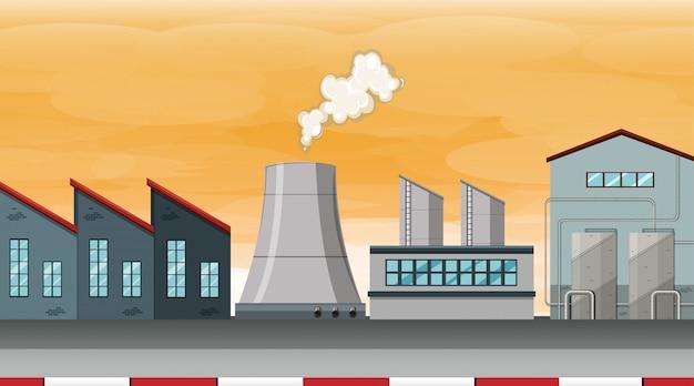 Scène d'usine de la pollution au coucher du soleil