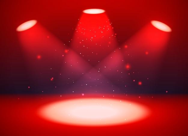 Scène vide avec trois projecteurs sur fond rouge