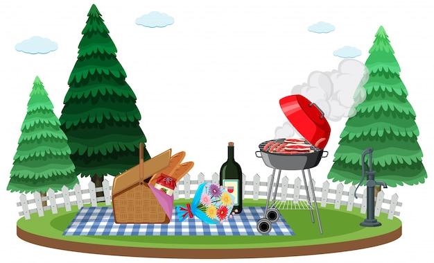 Scène avec vin et nourriture pour pique-nique dans le jardin