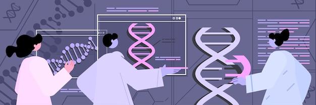 Scientifiques travaillant avec des chercheurs en adn faisant des expériences dans le concept de diagnostic génétique de test adn en laboratoire