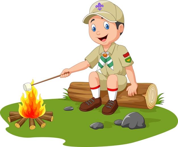 Scout de dessin animé rôtissant la guimauve