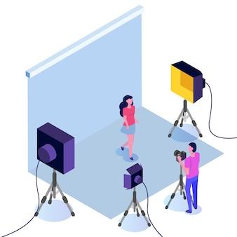 Séance photo isométrique, studio avec projecteurs et homme avec caméra.