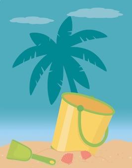 Seau de sable d'été et plage
