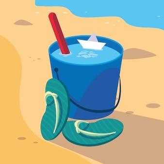Seau de sable à la plage