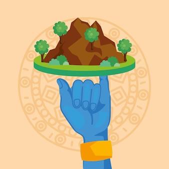 Seigneur de la main krishna soulevant la montagne