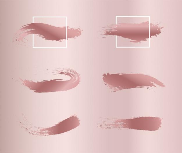 Série de coups de pinceau de peinture rose.