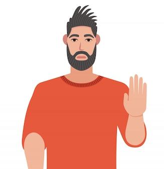 Sérieux homme barbu déterminé montre un geste d'arrêt avec sa main