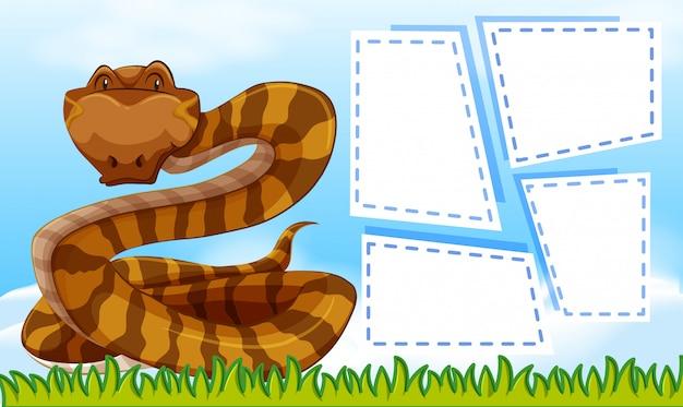 Un serpent sur des cadres de notes vierges