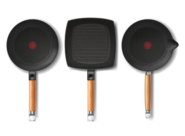 Sertie de poêles à frire noires réalistes de différentes formes, avec indicateur thermo-spot rouge