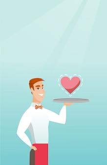 Serveur portant un plateau avec un coeur.