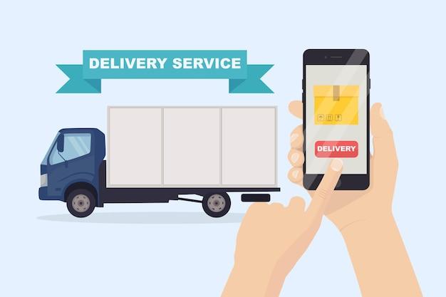 Service de livraison rapide gratuit par camion. main tenir le téléphone avec application mobile.