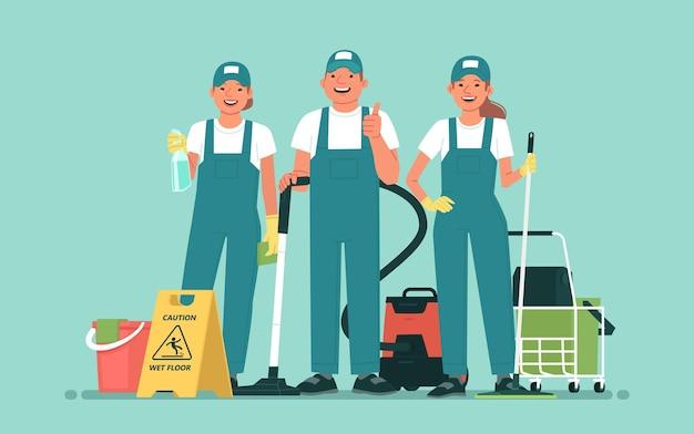 Service de nettoyage équipe d'employés heureux avec du matériel de nettoyage sur fond isolé