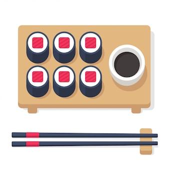 Set de cuisine japonaise, rouleaux de sushi avec des baguettes et des accessoires.
