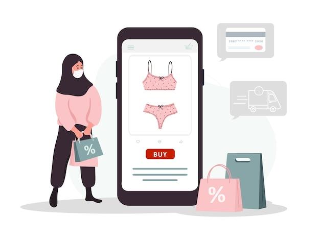 Shopping en ligne. une femme islamique achète des sous-vêtements dans une boutique de lingerie en ligne.