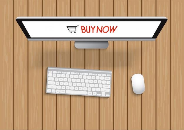 Shopping avec ordinateur et écran acheter maintenant sur table en bois. concept d'achats en ligne.