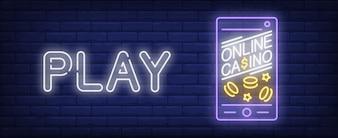 Signe au néon d'application de casino. Application de jeu en ligne sur smartphone
