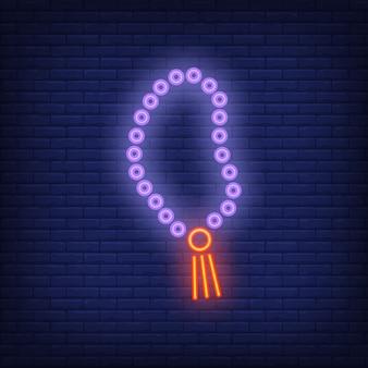 Signe au néon du rosaire. perles islamiques pour prier. publicité lumineuse de nuit.