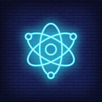 Signe au néon de la physique. mouvement des atomes. publicité lumineuse de nuit.
