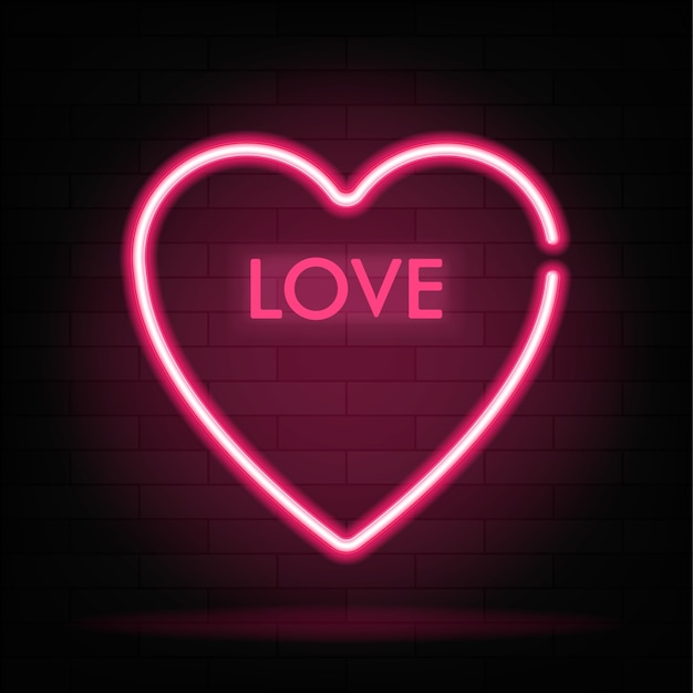 Signe de gradient néon du mot amour en forme de coeur sur fond sombre