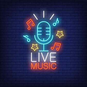 Signe de la musique au néon en direct. microphone, étoiles et notes de musique sur fond de mur de brique.