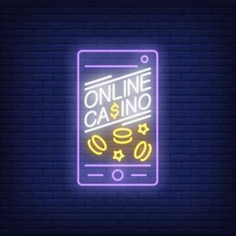 Signe néon de casino en ligne. Forme d'écran de téléphone avec des navires et des étoiles sur fond de mur de brique