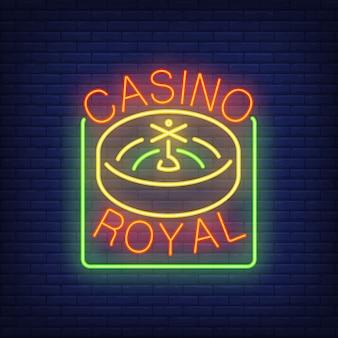 Signe néon royal de casino. roulette dans un cadre carré sur fond de mur de brique