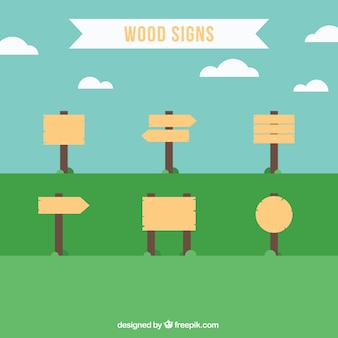 Signes en bois dans un style plat