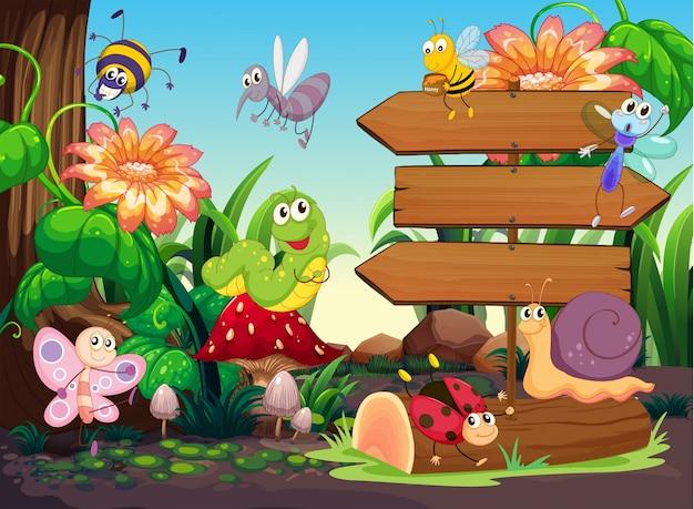 Signes en bois et insectes dans le jardin