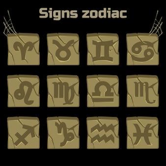 Signes du zodiaque et un ensemble de badges sur vieilles pierres