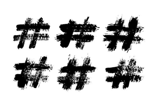Signes de hashtag de coups de pinceau d'encre. signe de communication vectoriel grunge pour blog, médias sociaux, logo, application internet, impression. main dessiner des icônes isolés sur fond blanc