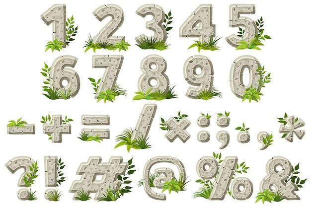 Signes de ponctuation de nombres en pierre avec l'herbe de feuilles