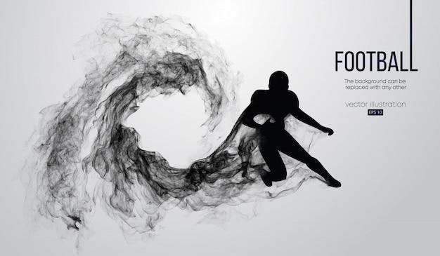Silhouette abstraite d'un joueur de football américain sur fond blanc à partir de particules, poussière, fumée, vapeur. joueur de football en cours d'exécution avec ballon. le rugby.