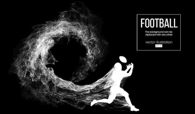 Silhouette abstraite d'un joueur de football américain sur fond noir foncé de particules, poussière, fumée, vapeur. joueur de football en cours d'exécution avec ballon. le rugby.