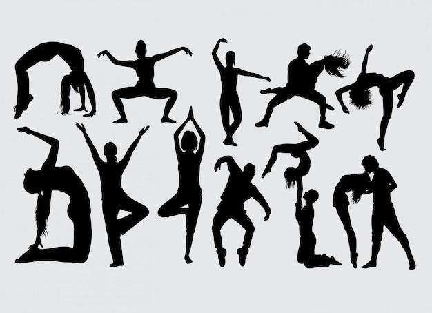Silhouette d'action masculine et féminine de danse moderne